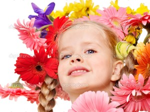 Child with  with flowers on her  hair.